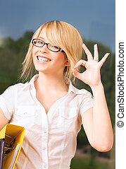 ok - bright picture of young businesswoman in office