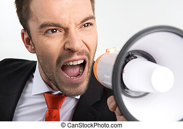 closeup on face of businessman holding megaphone. young guy...
