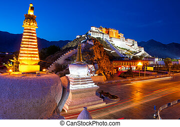 Potala Palace and stupa at dusk in Lhasa, Tibet