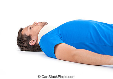 young man lying with cervical collar. handsome guy with neck...