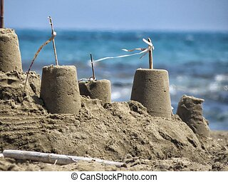 sand castle - a detail of a sand castle on the beach