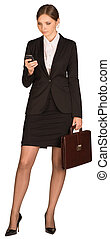 Businesswoman using phone and holding briefcase. Isolated on...