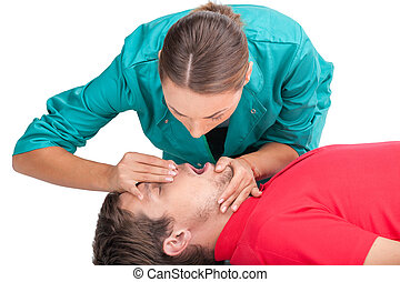 Young female giving patient CPR man receiving artificial...