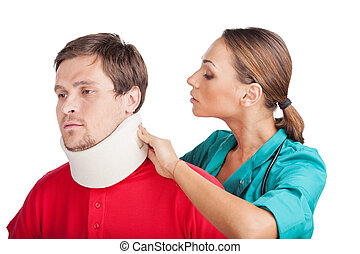 Young Man Wearing Cervical Collar doctor putting neck brace...