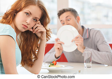 man licking plate after finishing lunch beautiful redhead...