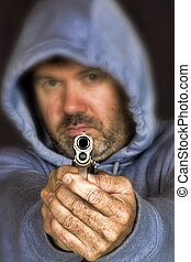 Thief or gang member holding a handgun - Thief or gang...