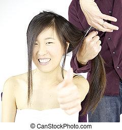 Happy asian girl getting long hair cut thumb up - Cute asian...