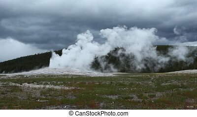 Old Faithful Geyser in Yellowstone National Park, Wyoming,...