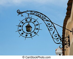 Medieval iron shop sign in shape of lantern and star -...
