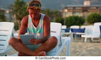 attractive men using digital tablet