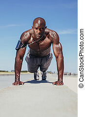 Shirtless young man doing push-ups - Image of shirtless...