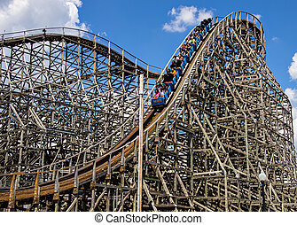 Roller Coster - Wooden Roller Coaster at a Theme park during...