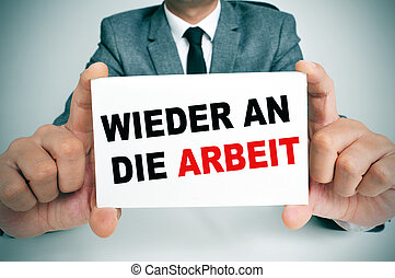 wieder an die arbeit, back to work in german - businessman...