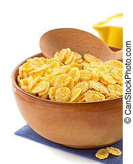 corn flakes in bowl on white - corn flakes in bowl isolated...