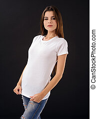 Woman with blank white shirt over black background