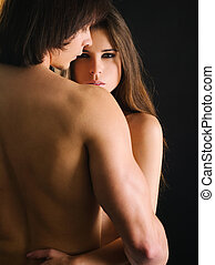 Young couple holding each other - Photo of a topless young...