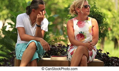 middle-aged couples discussing - husband and wife discussing...