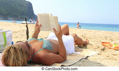 blonde women reading a book