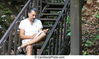 brunette man reading a book