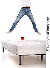 Mattress - Jumping on the mattress. Young man jumping on the...