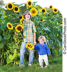 Two kids in sunflower field