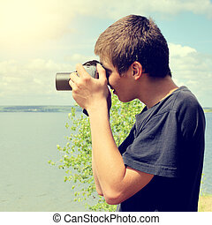 Teenager with Photo Camera - Toned photo of Teenager with...