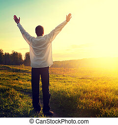 Happy Person at the Field - Toned photo of Praying Man...