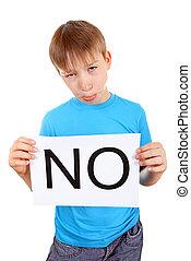 Kid hold Slogan NO - Sad Kid hold a sheet with slogan NO...