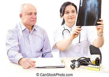 Doctor And Patient- X-ray test results - Women doctor...