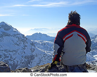 Man looking over mountains top