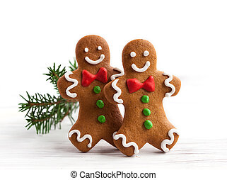 Gingerbread men - Smiling gingerbread men on white wooden...