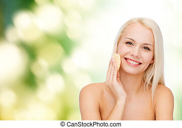 beautiful woman with sponge - health, beauty and spa concept...