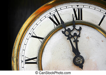 About twelve on old clock face detail, roman numerals