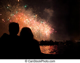 Fireworks over water in Venice - Silhouette of couple...