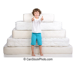 Children and many mattresses - Little boy sitting on a lot...