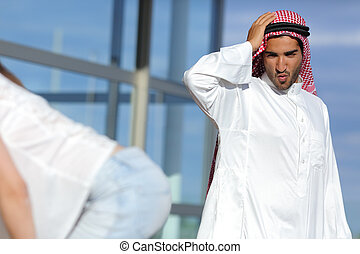 Arab man looking amazed a sexy girl butt in the street with...