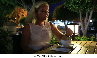 drinking coffee in a restaurant