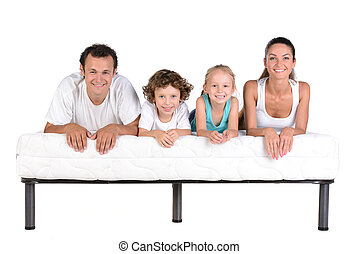 Family on the mattress - Family lying on mattresses,...