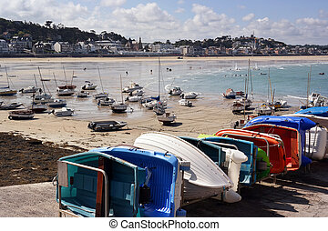 Ebb tide - Sailboats at ebb tide on the beach and small...