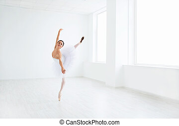 Dancing - Beautiful ballerina dancing in studio