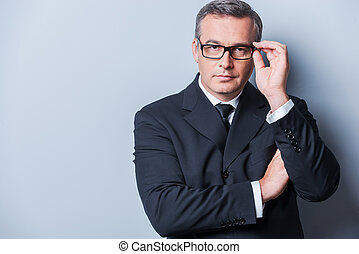 How may I help you Portrait of confident mature man in...