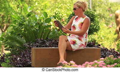 blonde women using digital tablet