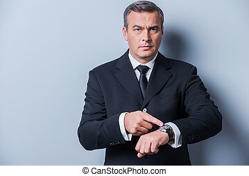 Time is money Confident mature man in formalwear pointing...
