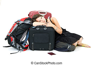 Weary traveller - Young woman resting on her luggage, weary...