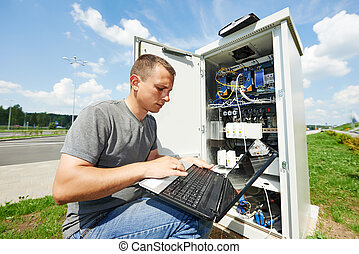 service engineer adjuster - engineer working with laptop...