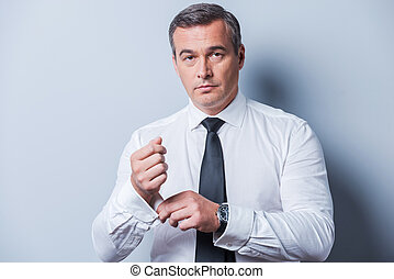 Making business look good. Confident mature man in shirt and...