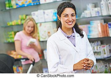 Pharmacy chemist portrait in drugstore - portrait of...