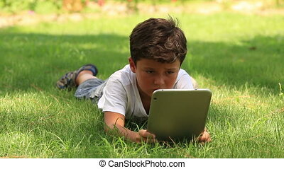 little cute kid using digital table