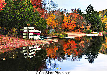 Fall forest reflections with canoes