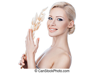 Nice girl. - Pleasantly smiling girl holding a withered...